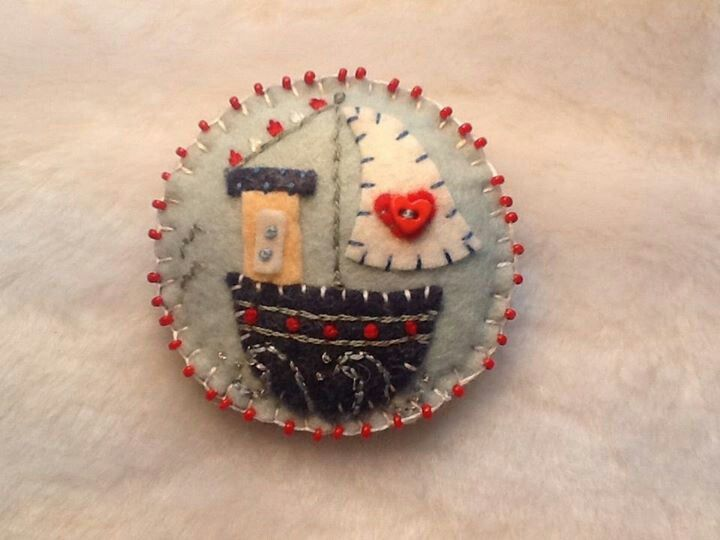 Handmade felt boat brooch, with embroidery and bead embellishments.