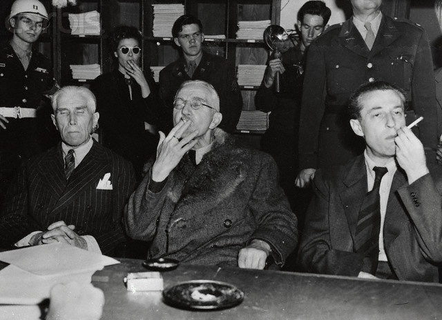 The three men who were acquitted of war crimes by the Military Tribunal which sentenced some of their former comrades to prison and some to the gallows, appear very much at ease as they are interviewed by newsmen the day after the verdicts were announced. Left to right: Franz Von Papen, Nazi diplomat; Dr. Hjalmar Schacht, financier, and Hans Fritzsche, propaganda chief. But all was not so serene. A cordon of 100 German policemen surrounded the Nuernberg jail early Oct. 3rd to rearrest the…