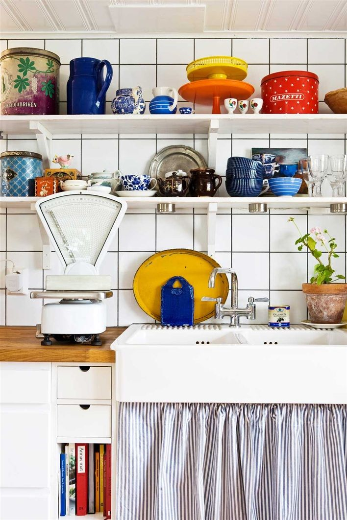 love white kitchens filled with colourful trinkets.