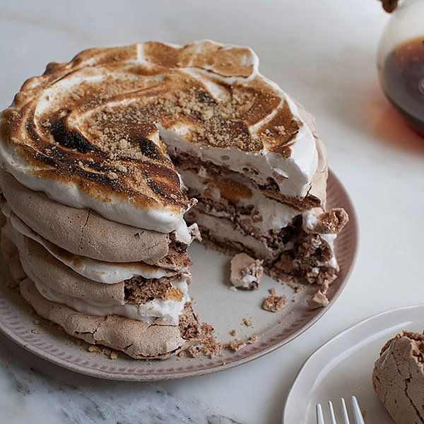 Make Your Fourth of July Weekend Extra Sweet With S'mores Pavlova: Make your Fourth of July barbecue a little sweeter with this s'mores pavlova recipe from blogger Adrianna Adarme of A Cozy Kitchen.