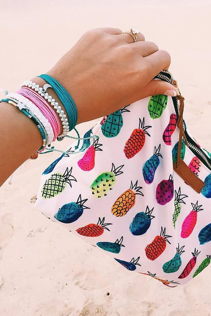 Our Pineapple Clutch + Stack of Pura Vida Bracelets  Use code TINASTRITMATER30 at checkout to save 20%