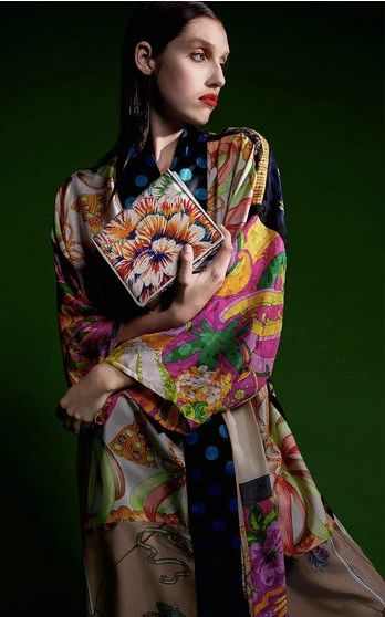 """The Berlin based duo (Rianna Nektaria Kounou ran a vintage store and Nina Kuhn headed up marketing for Galeries Lafayette) create colorful kimono robes and fold-over bags crafted from silk scarves sourced from around the world that offer plenty of """"Where'd you get that?"""" appeal. The answer? You'll find these special one-offs only on Moda."""
