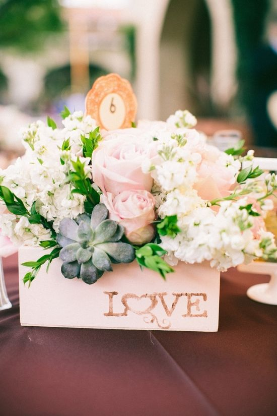 super cute floral centerpiece with diy love sign http://www.weddingchicks.com/2014/02/10/serra-plaza-wedding-san-juan-capistrano-aga-jones-photography/