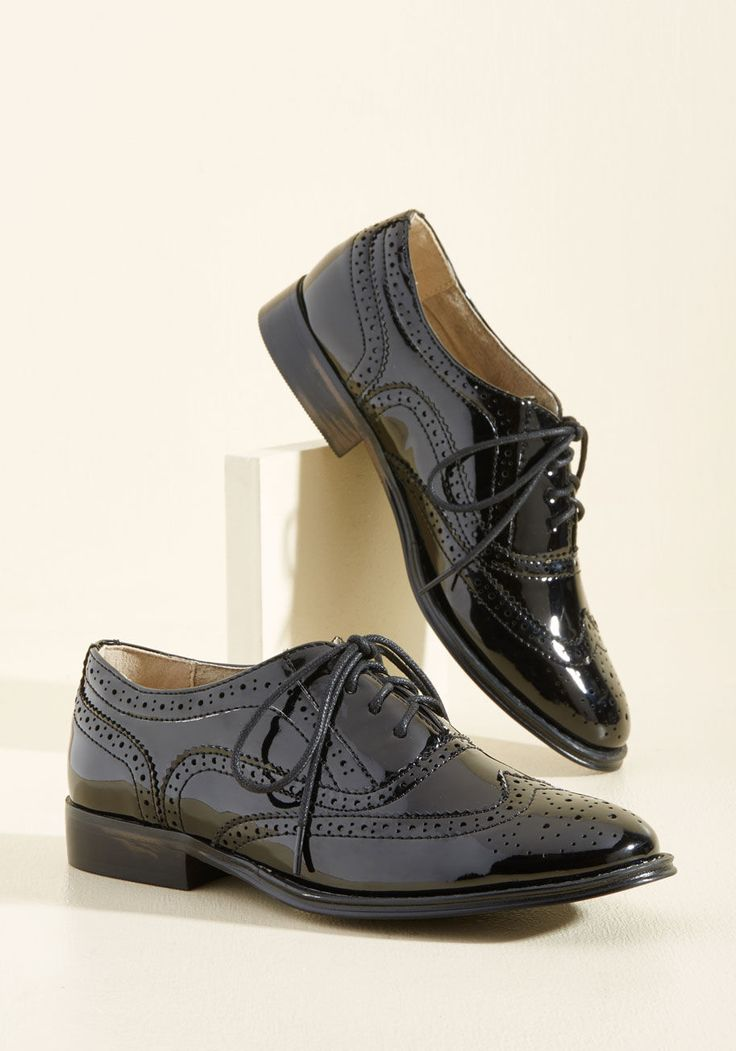 <p>And now for your feature presentation - these black patent wingtips! Totally classic, these retro, faux-leather kicks boast shiny uppers, perforated details, and tons of personality.</p>