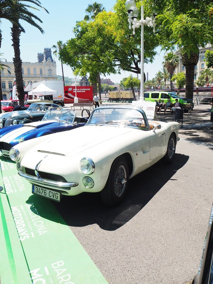 The cutest white soft top vintage car, by the Marina Barcelona