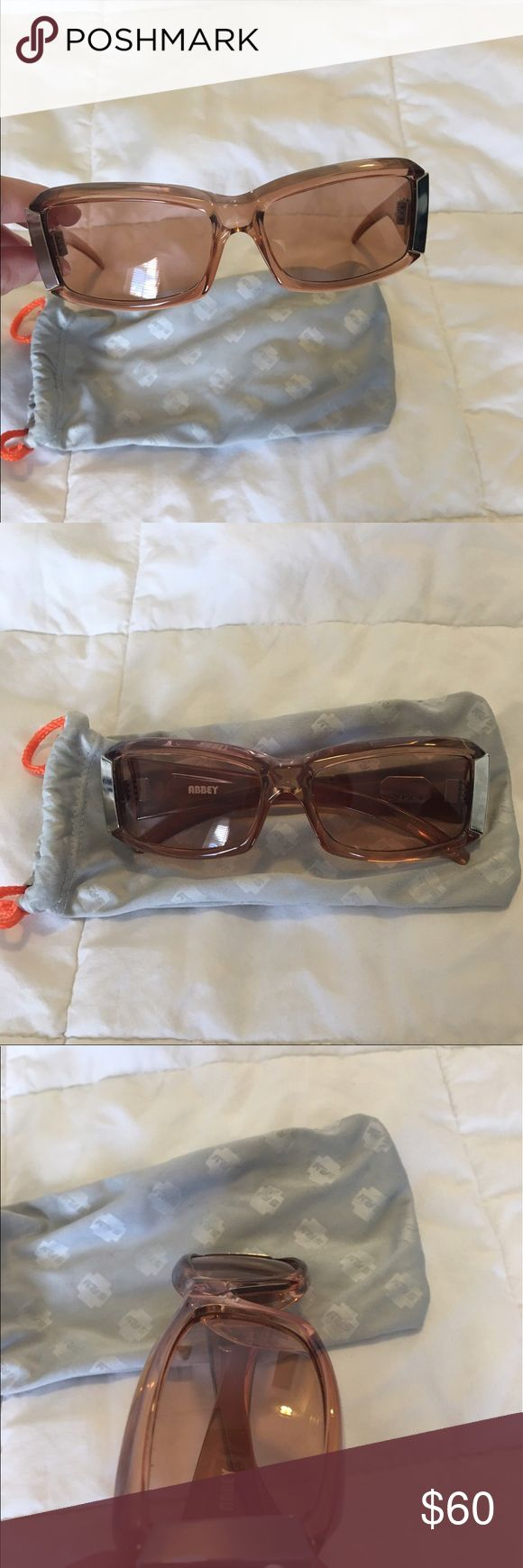 SPY Sunglasses These are the Abbey Spy sunglasses.  They've been worn once and come with a dust bag.  Dust bag has some marks on it. SPY Accessories Glasses