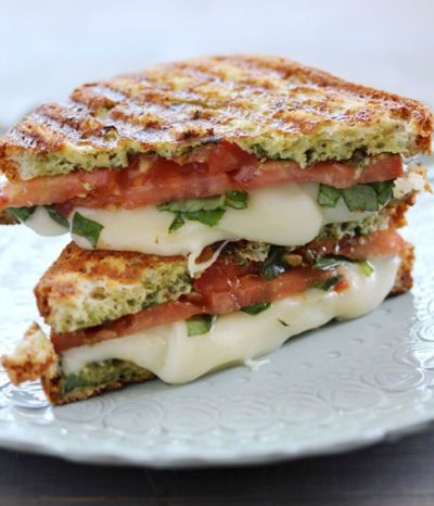 Want a fast, fresh, and healthy grilled sandwich? This tomato, mozzarella, and basil double decker sandwich will do the trick! You can use any bread, but a thin panini or wrap will do just fine!
