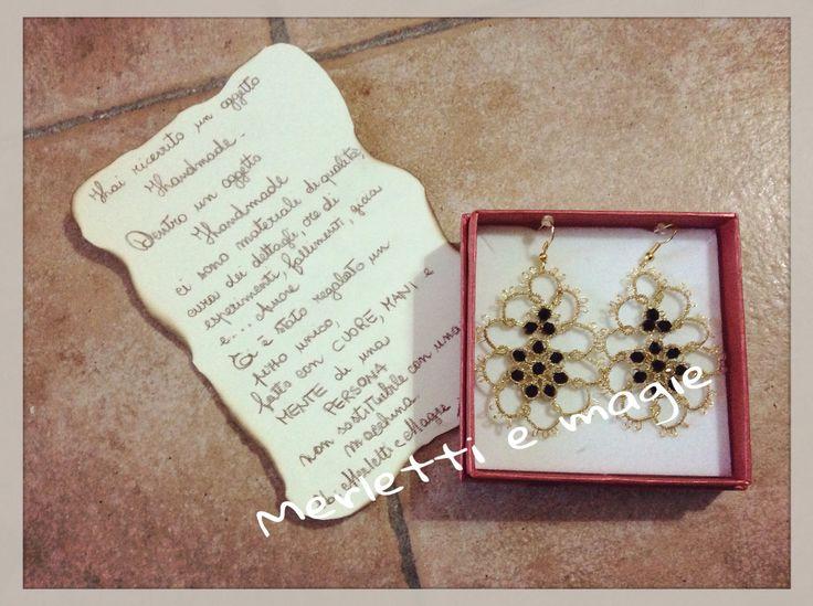 Orecchini oro con perline nere