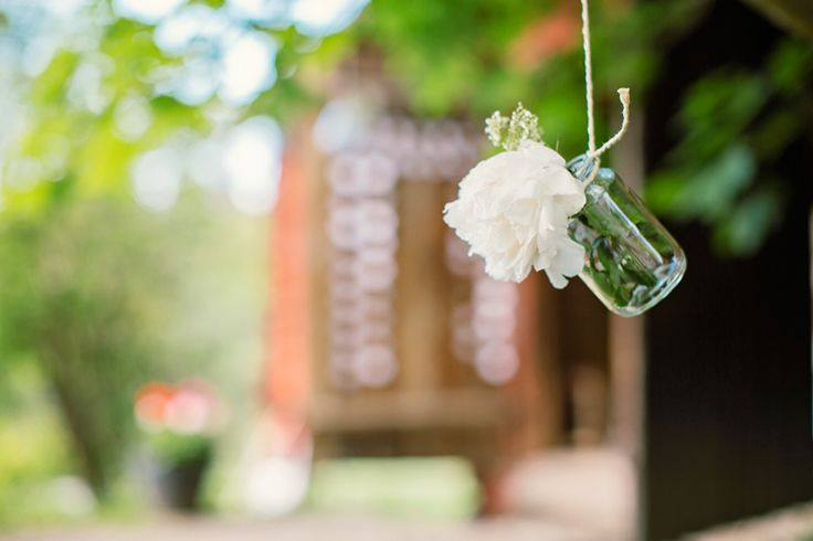 Hang old glasjars in a string with a flower or a candle!