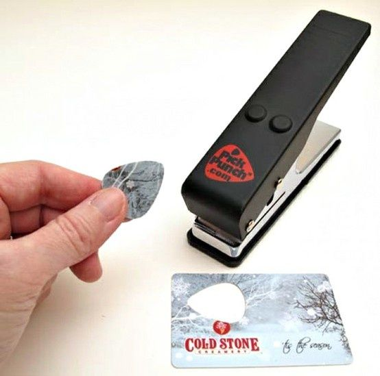 its like a hole puncher for old gift cards or credit cards and it makes guitar picks! i need one of these!