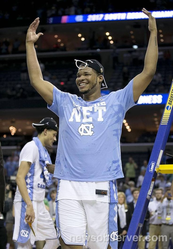 North Carolina's Kennedy Meeks (3) celebrates the Tar Heels' 75-73 victory over Kentucky as his teammates cut down the nets in the NCAA South Regional Final on Sunday, March 26, 2017 at FedExForum in Memphis, TN.