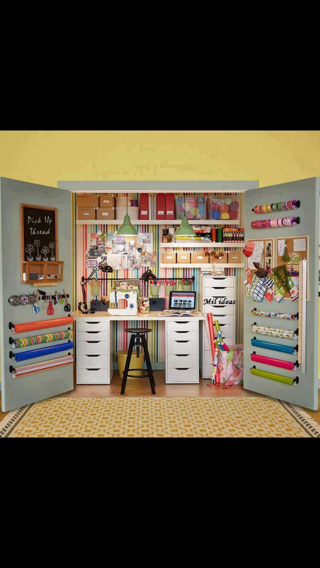Craft closet. Magnetic bar, wrapping paper rolls and ribbon roll storage - genius!