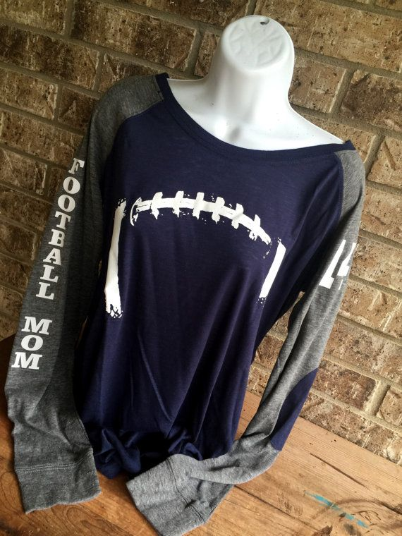 Show some FUN support for your favorite football player or team! * Laces on the front and Football Mom down one sleeve, # on the other (leave a note at checkout with # you would like)  * Feel free to change the wording if you would like- just leave a note at checkout  *THIS LISTING DOES NOT INCLUDE NAME OR # ON THE BACK- please check the other listings in the store- Below is the link to ADD it…