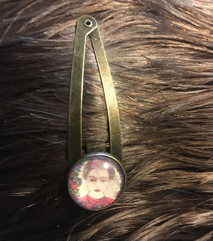 A personal favourite from my Etsy shop https://www.etsy.com/au/listing/478498410/frida-kahlo-art-hair-clip-original