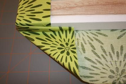Folding fabric around canvas to make wall art.