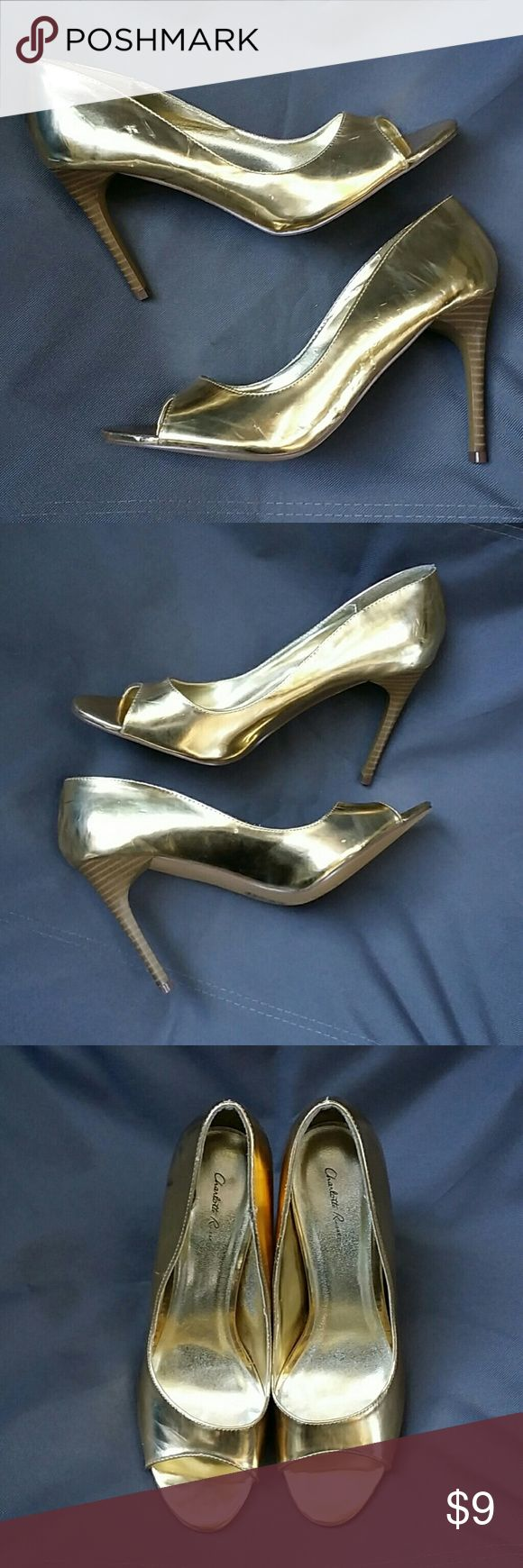Gold peep toe heels size 9 Gold peep toe high heel - Charlotte Russe - purchased them from another posher and unfortunately they do not fit me - some scuffs on the sides barely noticeable - feels like new Charlotte Russe Shoes Heels