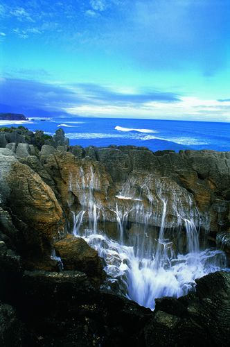 Visit Punakaiki, West Coast of the South Island, New Zealand, and be impressed with the water gushing in this blowhole.