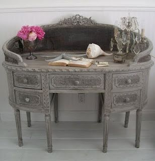 I love desks.  My husband has refused to let me bring anymore home.  But I really like this one.