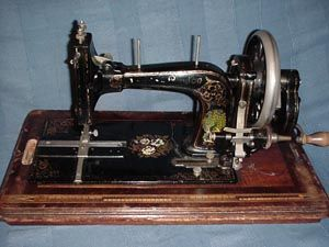 Faudels: Serial No. 659437.  Imported and badged by Faudels of London who purchased sewing machines from various German manufacturers. This particular machine is believed to have been made by Haid & Neu around 1900.