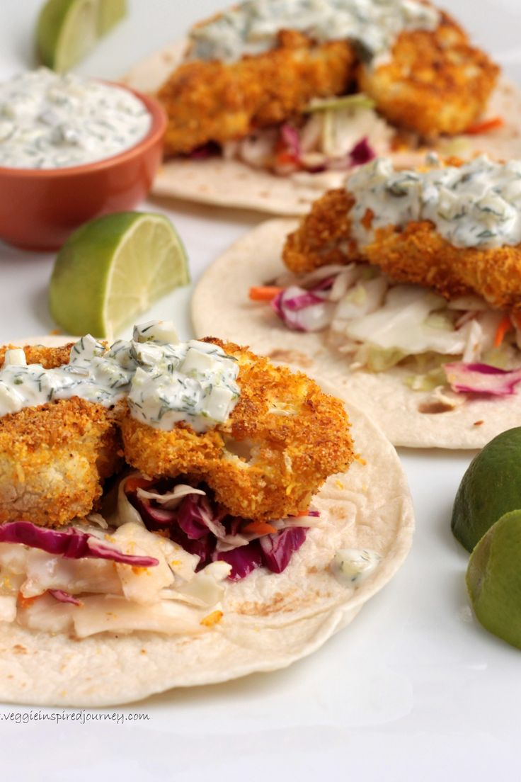 Crispy Coconut Lime Cauliflower Tacos. Ingredients: cauliflower, coconut milk, lime, salt, breadcrumbs, cornmeal, shredded coconut, paprika, cumin, garlic powder, tumeric, s and p. Slaw - red and green cabbage, carrots, vinegar, maple syrup...
