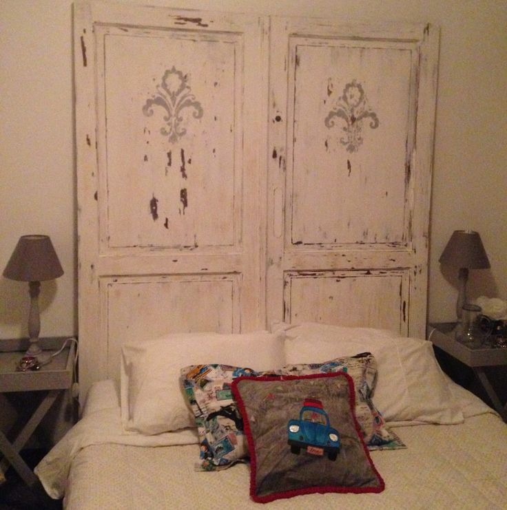 An almost freebie room makeover - I bought the chalk paint for the butlers trays and new lampshades. The double doors were rescued from a builder (Ryno Gous) en route to the dump. Painted them white, sanded them, added the grey damask. Made the decor pillows myself.