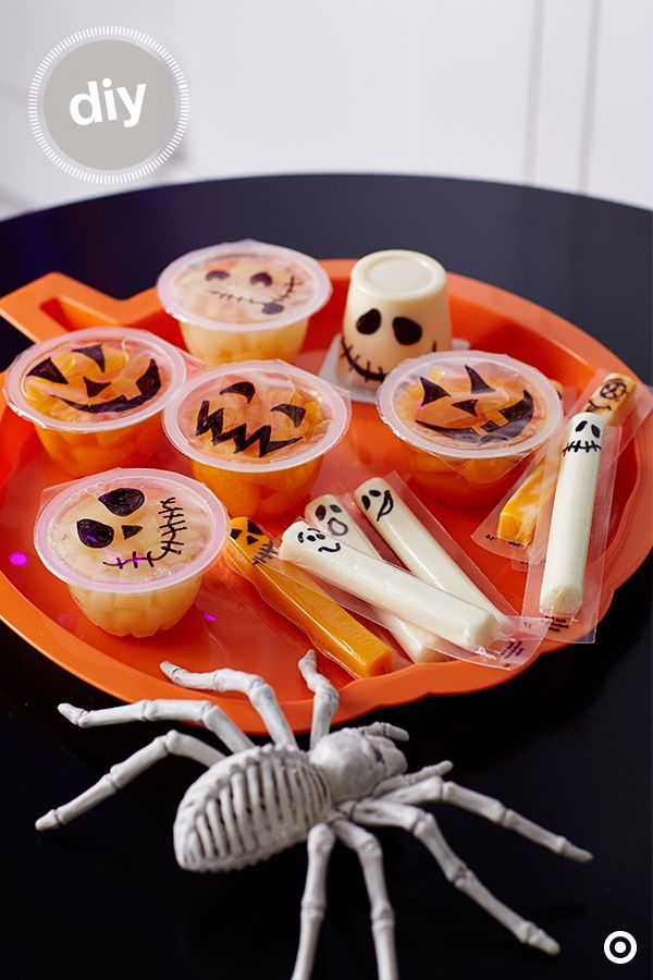 Change things up for trick-or-treaters this year by offering healthier options, like string cheese and fruit cups. Turn the snacks into ghosts and jack-o-lanterns with just a black permanent marker. Parents will appreciate a break from all the candy, and kids will love those festive faces.