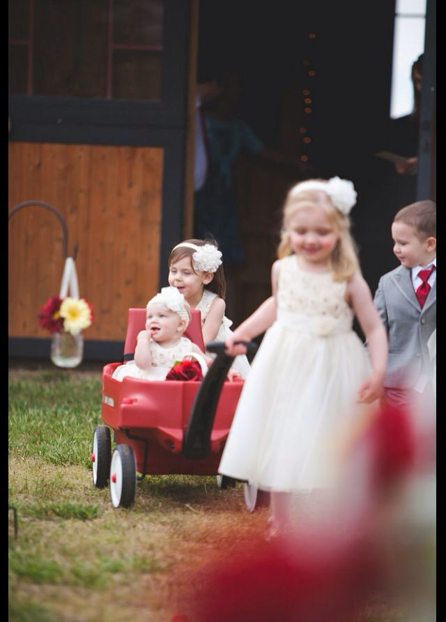Our older flower girls pulled the youngest flower girl in a wagon. So much fun and absolutely precious!!! Great way to make sure you are able to include the young ones, even if they aren't able to walk yet! #rusticwedding #flowergirls #wagon Photo cred: @melodiemaynard from Mellow Yellow Photography