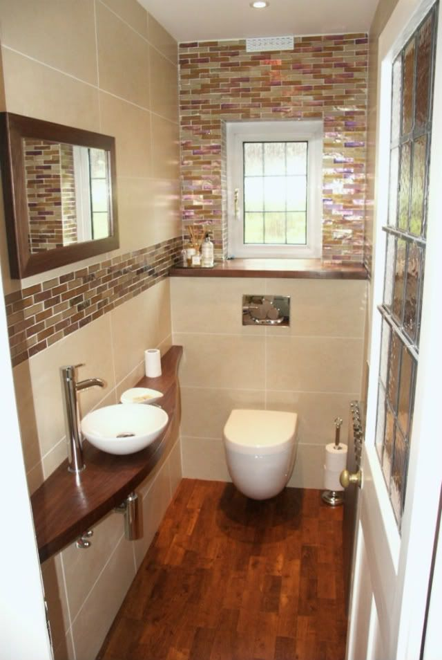 Pretty little cloakroom but wouldn't have wood in a bathroom again. Difficult to maintain. Water and soap damage happens quickly.