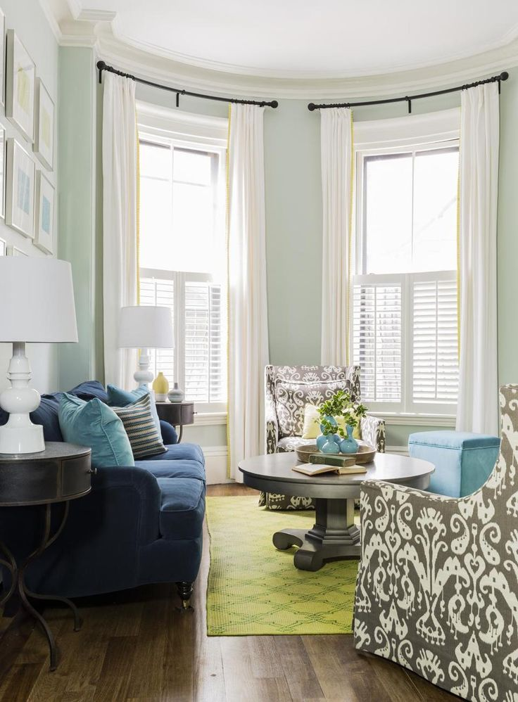 navy blue sofa, gray ikat chairs, light teal walls, lime green carpet, painted gray coffee table, Ivory curtains