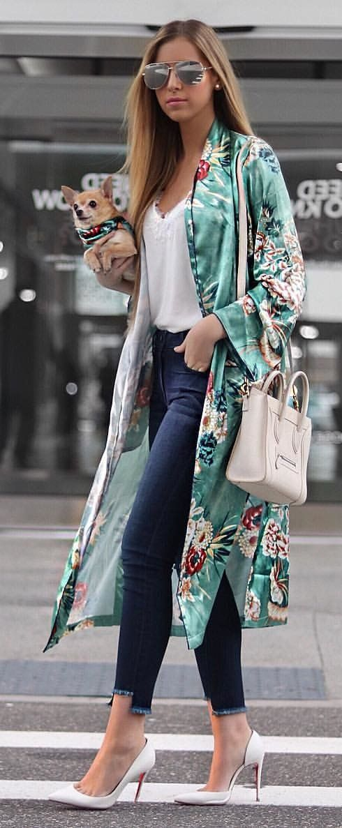#spring #outfits woman in teal and white floral cardigan walking street while holding adult brown Chihuahua. Pic by @styleitwithtrix
