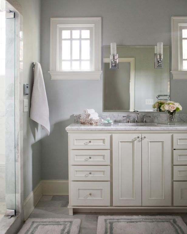 Pale Blue Bathroom With Craftsman Windows, White Vanity & Bath Mats.  I like the vanity/cabinet:  Drawers on each side, and doors hiding what's under the sink.