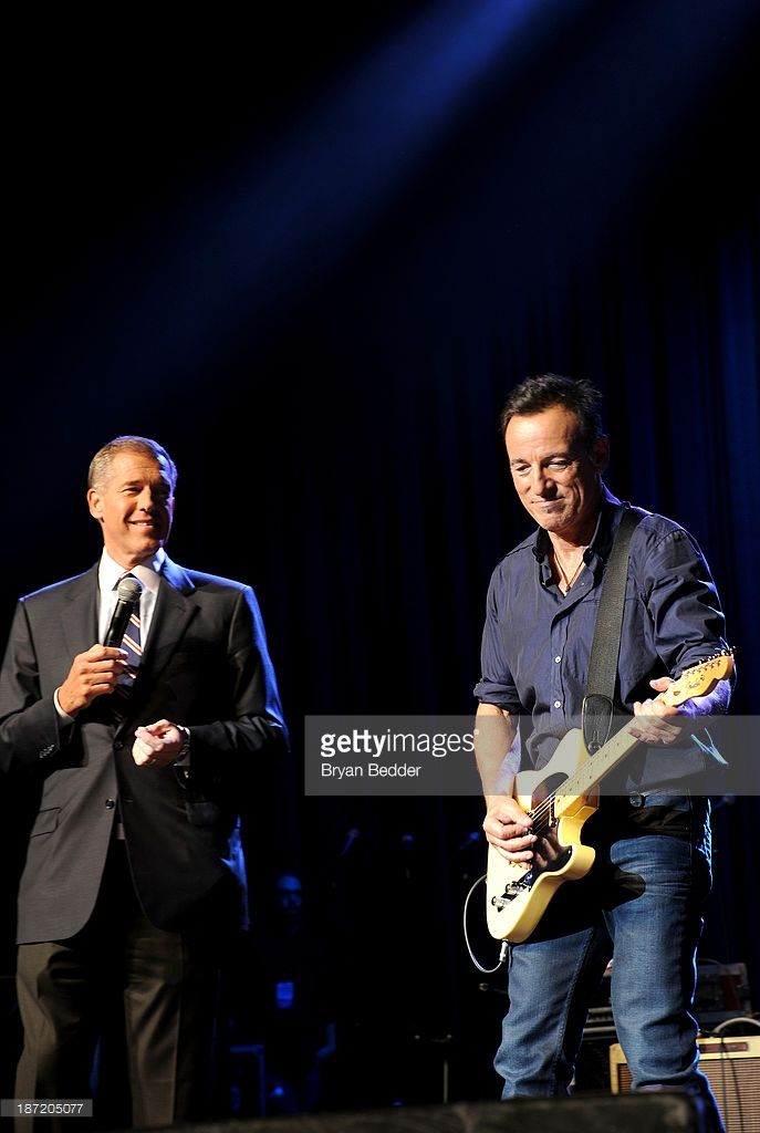 Brian Williams and Bruce Springsteen onstage at The New York Comedy Festival And The Bob Woodruff Foundation Present The 7th Annual Stand Up For Heroes Event at The Theater at Madison Square Garden on November 6, 2013 in New York City.