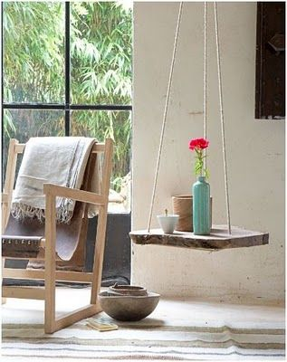 Hanging Table. I have seen hanging dining tables before and always thought they were lovely, but stupid. 6 people sitting down to eat, each of them trying to cut their meat on a table that swings? I think not. A hanging plant stand that also serves as a side table might just work in an outdoor space.