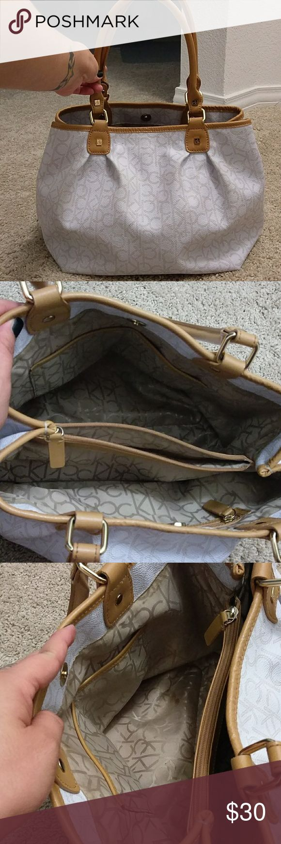 Calvin Klein bag Used, a couple of marks on the bottom from normal wear. Dims are 15X6X11. Handles are 8 inches long. One middle zipper compartment, one side zipper pocket and two individual opposite side pockets. Calvin Klein Bags Shoulder Bags