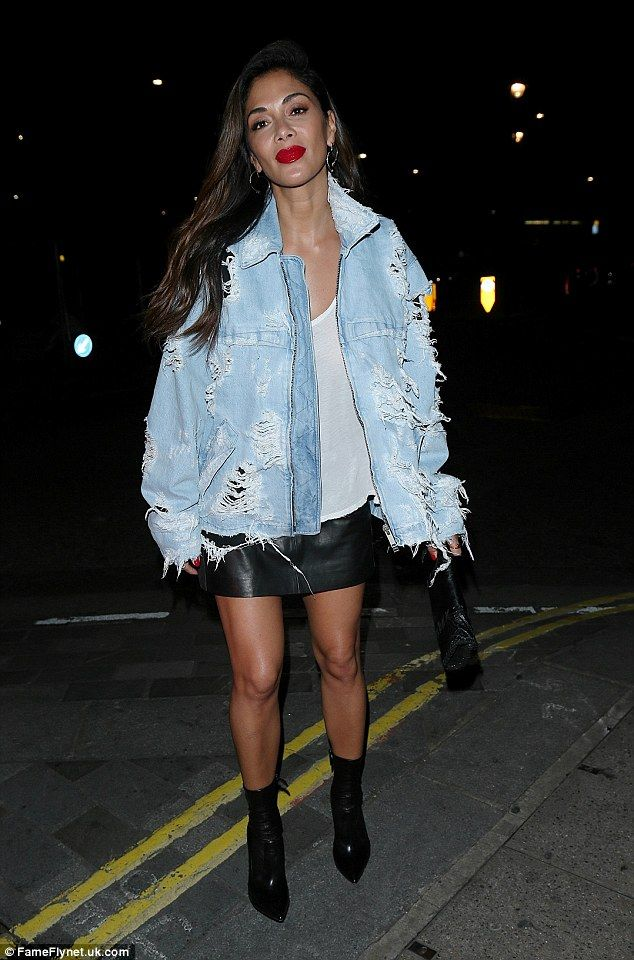 Sushi time: Pussycat Dolls legend Nicole Scherzinger looked leggy in a sexy leather mini s...