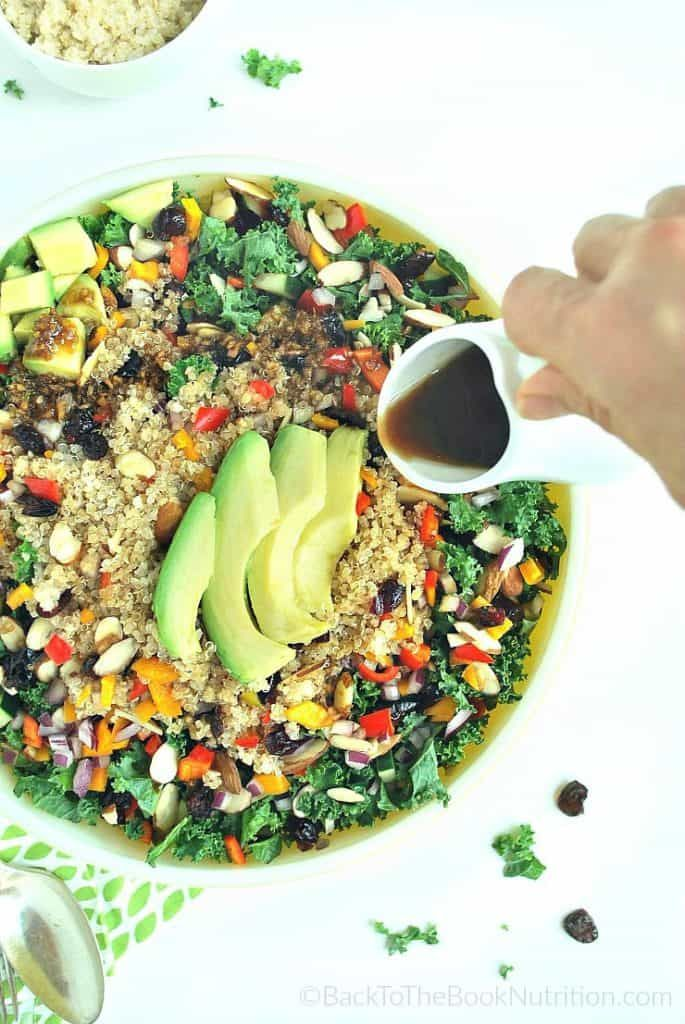 This hearty kale, quinoa, and cranberry salad is loaded with flavor and texture + health benefits of antioxidants, prebiotic fiber, healthy fats, & more!