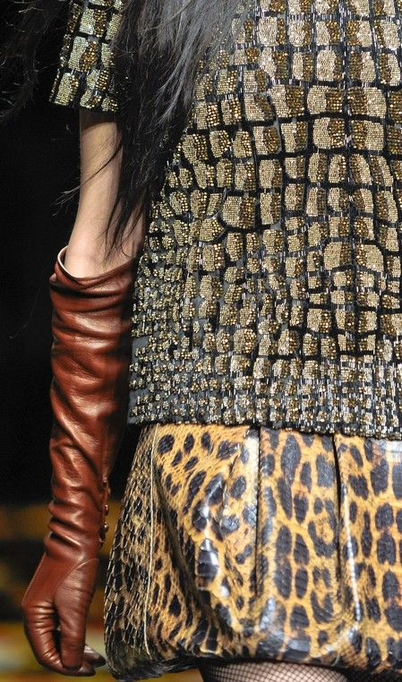 #RobertoCavalli FW 2012-13. We're loving accents of reptile print this season...