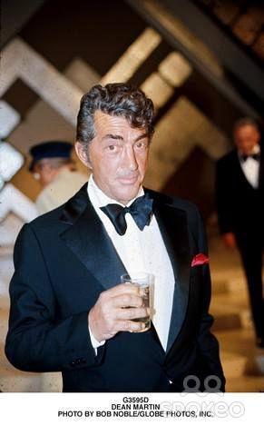 The good old Dean look, love it , the exact persona (faked image of the boozing man) Dean wanted to transmit to his fans after leaving the Martin & Lewis team of comedy - the trick worked and a new niche was found -web photo -MReno