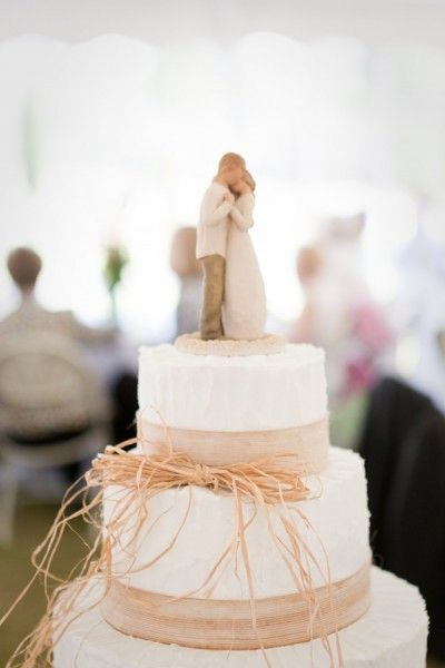 willow wedding cake topper with rustic detailing. Cakes like this are simple and classic. Over-the-top wedding cakes tend to have a few things in common: cost tons of money, usually don't taste that good and are so fancy no one wants to eat it because they would rather look at it.
