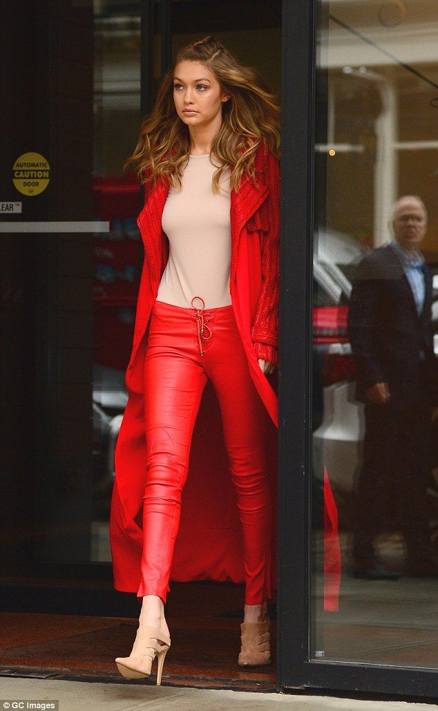 Lady in red! Gigi Hadid wears bright scarlet coat and skin-tight leather pants as she steps out in New York | Daily Mail Online