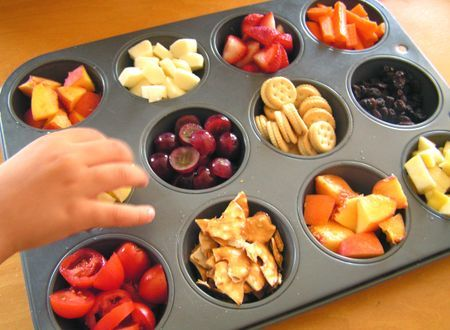 I really like this idea for a toddler lunch/snack tray.  I'd substitute a few of the items, but it would work well for my Chicken Little.