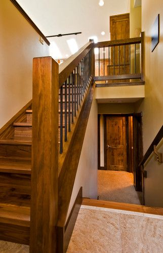 Wooden banister with iron rods