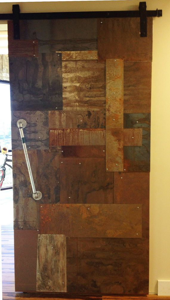 Reclaimed distressed weathered sheet metal clad by for Metal barn doors