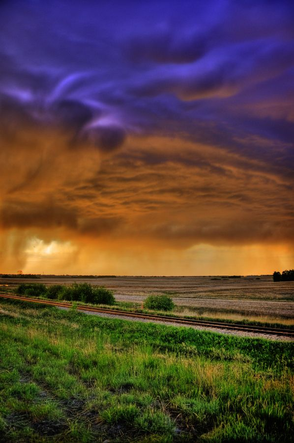 Saskatchewan Summer Storm {I don't like the clouds per se, and the colours are obviously enhanced, but I like the colour scheme, and that it includes green in the landscape}