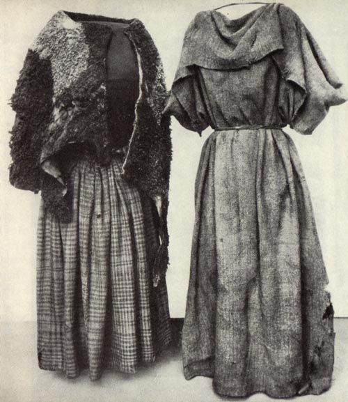 "Women's clothing from the swamps in the Huldremose in Denmark-unfortunately, the date is ""the iron age""... (L) garment is wool, woven... ""Cape"" was probably lamb...  (R) garment is wide ""scarf"" together only at the neck with a skewer from bird bones. (I see something similar to the (R) garment, made with towels, in the shower houses. )"