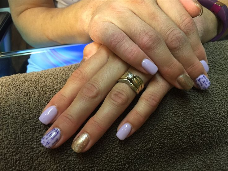 Lavender & gold sparkle nails with Arrows, done by Melissa at essential balance in Quesnel BC!!