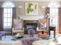 Go from cavernous to cozy in your living room with defined areas, warm colors and lighting that's up to the task