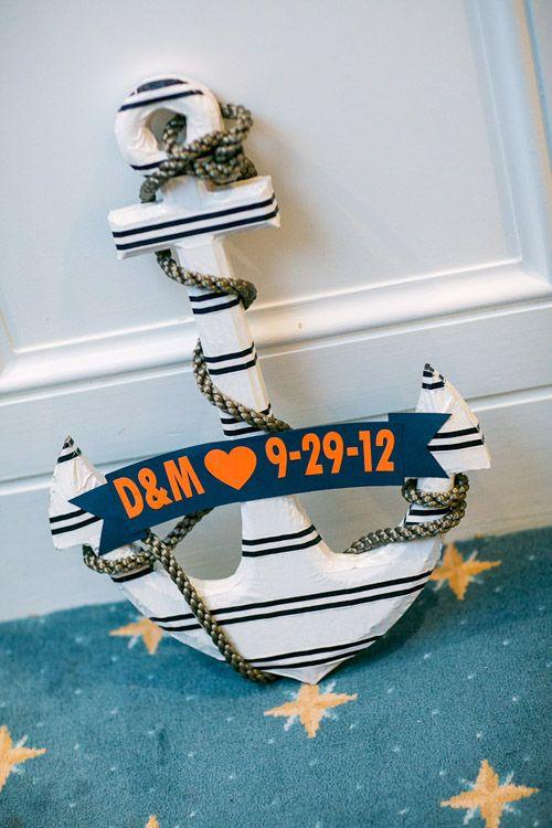 adorable anchor decor for navy and orange nautical style wedding, photo by Sarah Tew Photography | via junebugweddings.com