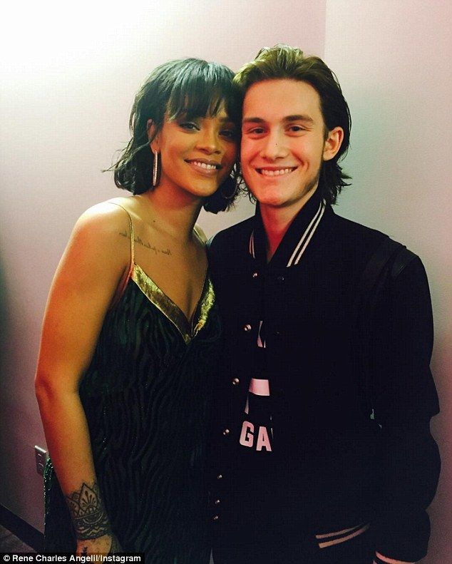 Big fan: An excited René-Charles Angelil, 15, posed with Rihanna backstage at Sunday night...