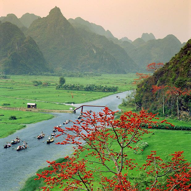 Beautiful boat trip with green hills on both side of the Yen river to the Perfume pagoda (Vietnam). 2004